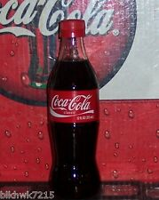2008 COCA - COLA 12 OUNCE GLASS BOTTLE WITH PAPER LABEL AND TWIST - OFF CAP FULL