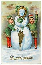 BONHOMME DE NEIGE ENFANTS TREFLE FER A CHEVAL. SNOWMAN CHILDREN CLOVER HORSESHOE