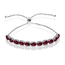 Oval-cut 7x5mm Created Ruby Adjustable Tennis Bracelet in Sterling Silver