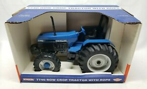 New Holland Ford 7740 Row Crop Tractor With Rops & FWA By Ertl 1/16 Scale NIB