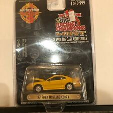 1/64 RACING CHAMPIONS MINT 1997 FORD MUSTANG COBRA YELLOW