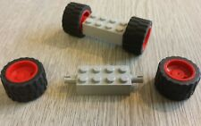 Lego wheels. 2 sets. Low profile tyres red hubs 2x4 grey axle bricks. Free post