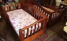 Two wooden children's beds