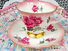 ROYAL ALBERT RAINBOW EFFECT TEA CUP AND SAUCER WITH PINK CARNATIONS