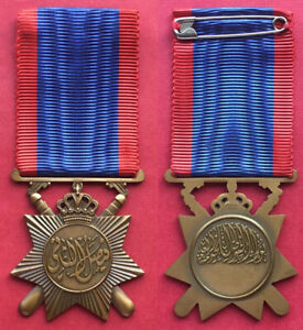 IRAK KINGDOM , FAISAL II POLICE GENERAL SERVICE BY HUGUENIN -TOP ,EXTREMELY RARE
