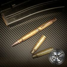 Battle-scarred Brass 308 / 7.62 bullet pen. Hand crafted from genuine bullets.
