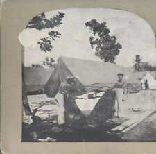 STEREOVIEW OF SAILORS IN UNIFORM PUTTING UP TENTS IN CAMP