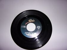 Charly McClain: Let's Put Our Love In Motion / I'm Puttin' My Love Inside You 45