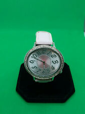 ladies avon silver tone fashion watch,with a silver & pink face,pink strap,b3.