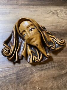 Handmade leather woman face mask for decor and wall hanging