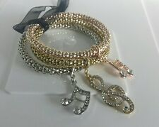 Gold Plated Set Of 3 Clear Stone Expanding Musical Charms Bracelets.