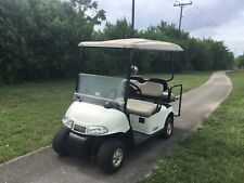 White 2008 GAS Ezgo rxv 4 passenger flip seat golf cart extended canopy lights