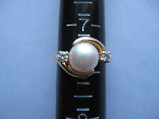 GOLD RING WITH SINGLE PEARL AND 2 DIAMONDS 14k