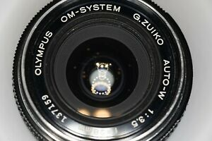 Olympus G.Zuiko Auto-W 28mm 3.5 manual lens w/original metal hood, caps, filter