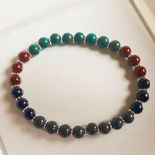 Beaded bracelet on elasticated string.
