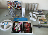 Nintendo Wii Bundle Four Controllers Four Nunchucks Six Games Adapters Wheel
