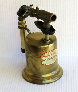 ONE-QUART BLOWTORCH: PUMP IN HANDLE: COBRA ALWAYS RELIABLE: UNUSUAL FEATURES