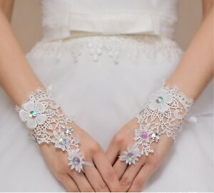 a pair of ivory rainbow beaded wedding lace gloves bridal floral