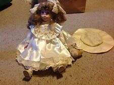 "Baby Doll with Porcelain ? Face, feet and hands.     17""  long.  Used."