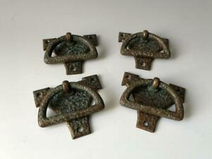 Set of four copper Arts & Crafts drawer handles, circa 1900 to 1910.