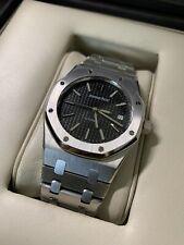 Box & Paper. Audemars Piguet Royal Oak Black Dial Stainless Steel Watch 15300ST