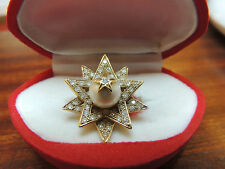 Bague 'étoile' or 18 carats diamants et perle