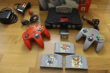Nintendo 64 con Mario Party 2,3 Super Smash Bros. Bomberman expansión/contr. Pak