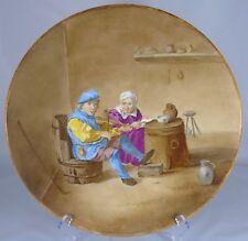 Beau plat en faïence à décor de scène de taverne. XIXe s. Diam. 33,5 cm
