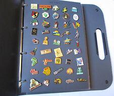 Classeur 135 pin's complet / nombreux thèmes (lot vendus avec attaches)