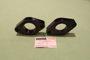 Two new original Yamaha TZ250 inlet manifold spacers 329-13565-01