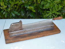 traditional French antique baguette bread cutter. guillotine style