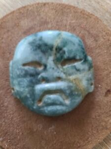 Pre-columbian olmec jade mask pendant from Mexico. Ca. 300 bc