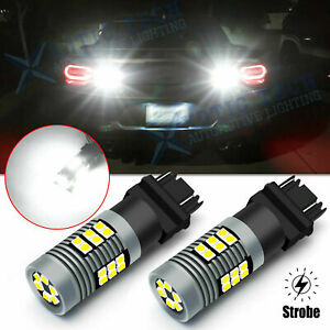 LED 3057 3157 White Legal Strobe Brake Backup Reverse Light Bulbs Flash to SOLID