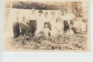 Makeshift tent and Agricultural workers ? Hop Pickers ? Postcard size photocard.