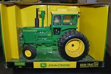 1/16 John Deere 6030 tractor w/ cab & duals by Ertl very nice new in box