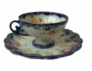 BLUE HAND PAINTED FLORAL TEA CUP AND SAUCER