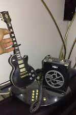 Original Gibson guitar telephone. Play guitar songs when ringing.