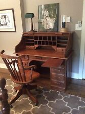 SolId oak rolltop desk with matching swivel chair. Dovetail construction.