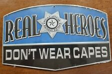 """COLLECTIBLE EMBOSSED METAL SIGN """"REAL HEROES DON'T WEAR CAPES"""" POLICE"""
