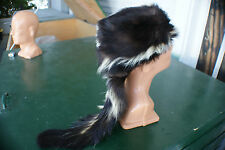Skunk hat fits all size. turquoise lining. w/ long tail. nice. value priced.