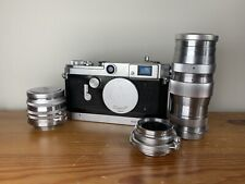 Canon VT 35mm Rangefinder Film Camera lot with multiple lenses and more.