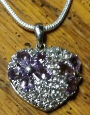"""Floral natural amethyst necklace hanging on an 18"""" sterling silver snake chain."""