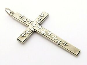 Large sterling silver pendant shape of cross with decoration of lots of crosses