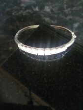Sterling Silver bracelet. Nine cubic zirconia stones. clasp to close. Lovely