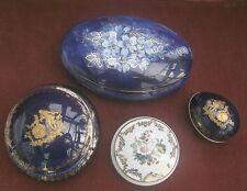 Limoges trinket boxes set of 4 . Highly decorative