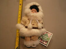 PORCELAIN ESKIMO DOLL 10 INCHES TALL