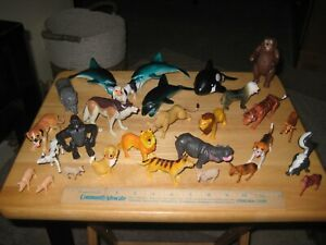 Animal Figures assorted lot Lions Dogs Dolphins etc. 28 included
