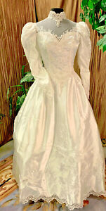 Long sleeve Michaelangelo  80's white satin wedding dress renaissance faire gown