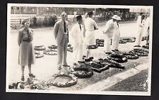 C1950s Photo Card taken in Kuala Lumpur - female soldier & civilian with wreaths