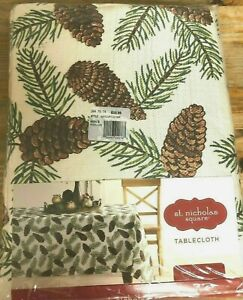 "St. Nicholas Holiday Pine Cone & Leaf Tablecloth, 90"" Round Ivory Multi $25.99"